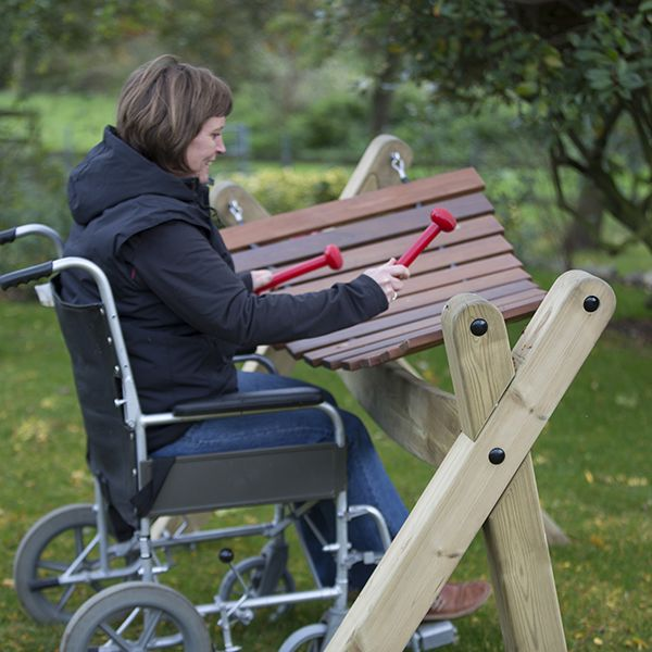 Lady in Wheelchair Playing Outdoor Akadinda