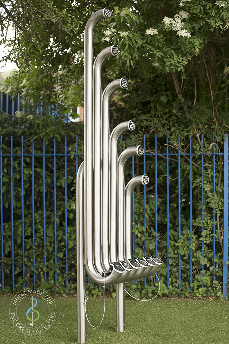 large silver outdoor aerophones or slap tubes in school playground