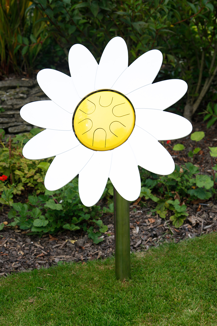 an outdoor musical drum in the shape and colours of a daisy