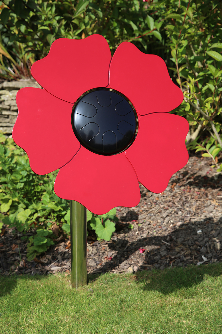 an outdoor musical drum in the shape and colours of a poppy