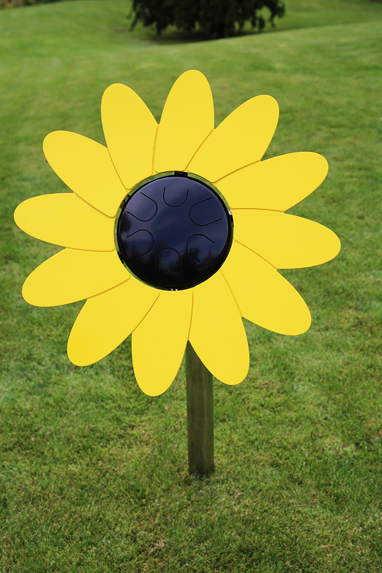 an outdoor musical drum in the shape and colours of a sunflower