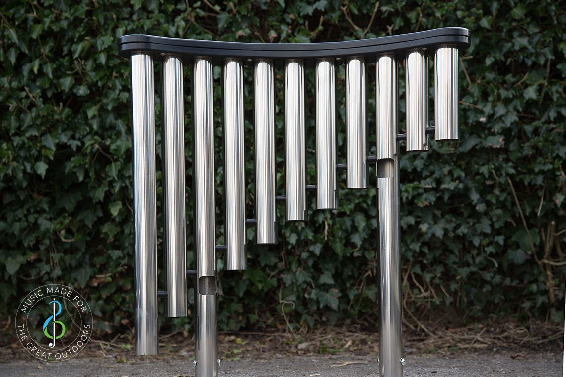 looking at the shiny downpipes of a large outdoor musical instrument