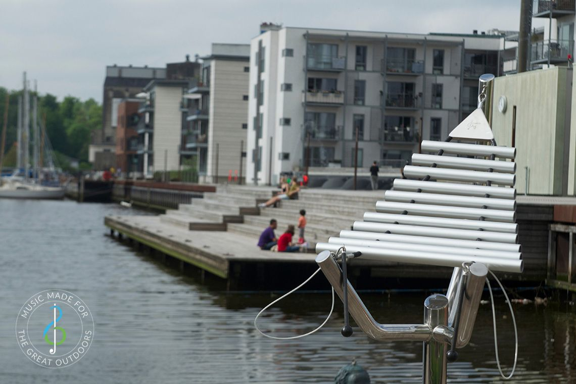 large metal outdoor xylophone on quayside setting
