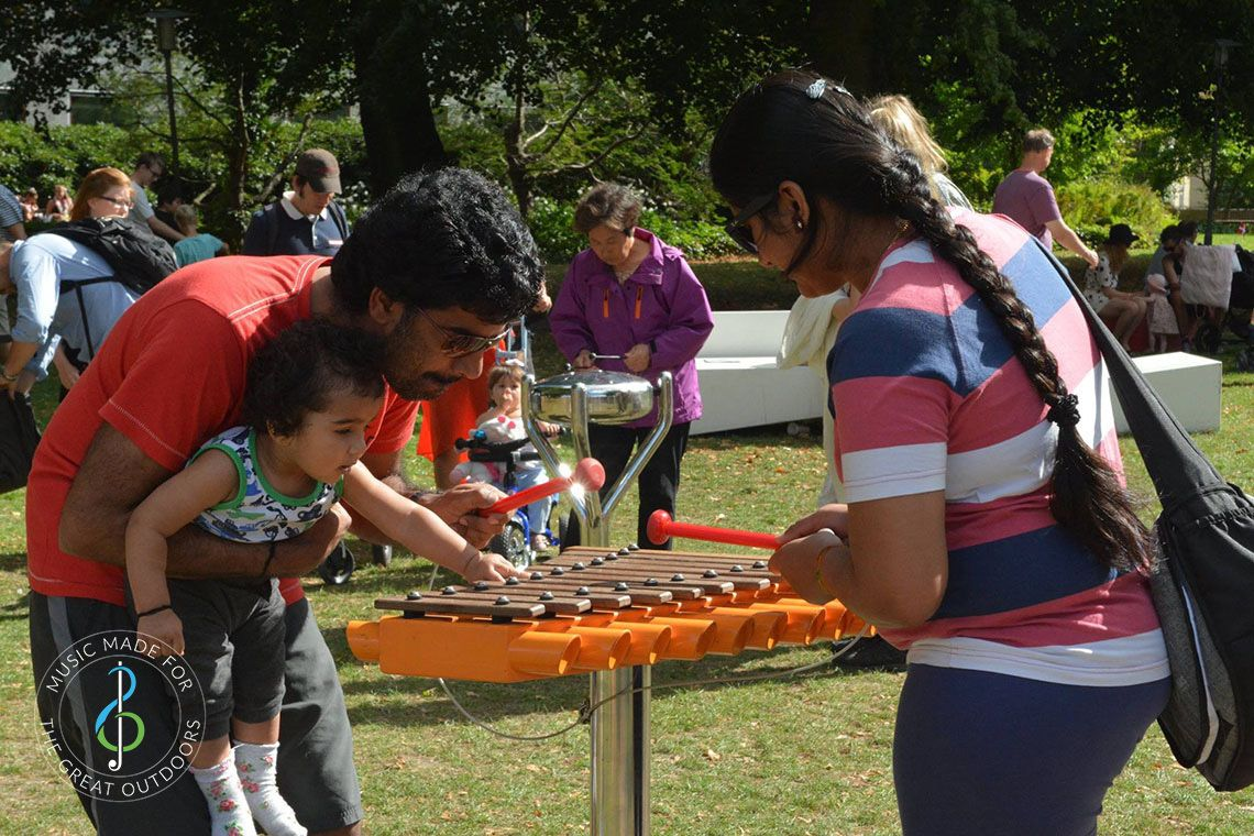 Indian Family Playing Small Outdoor Xylophone