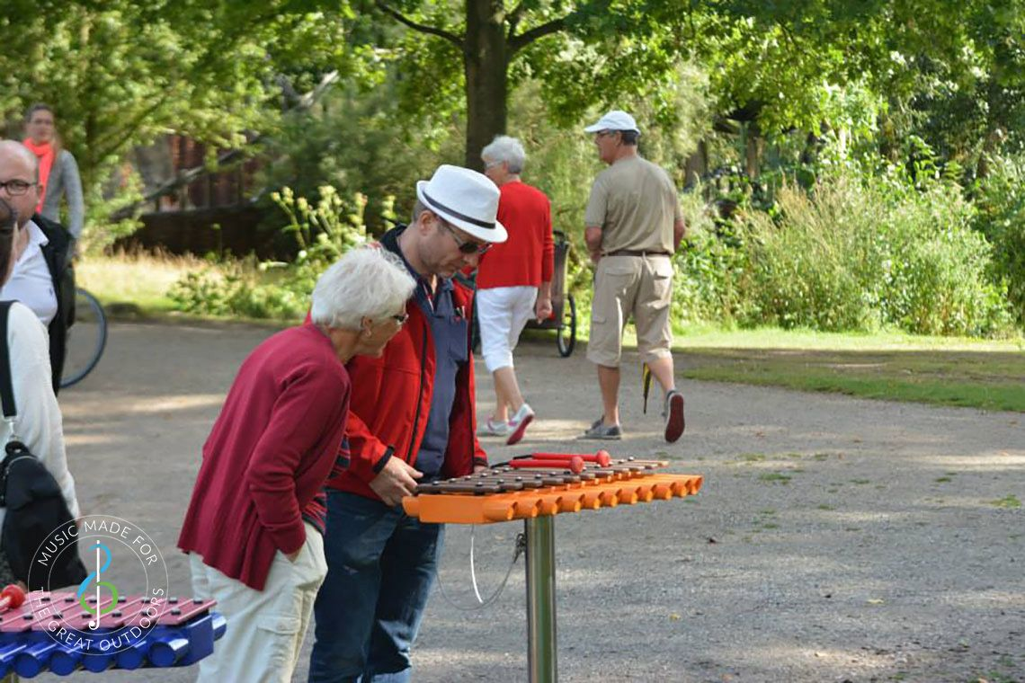 Older Couple Playing Outdoor Xylophone in the Park