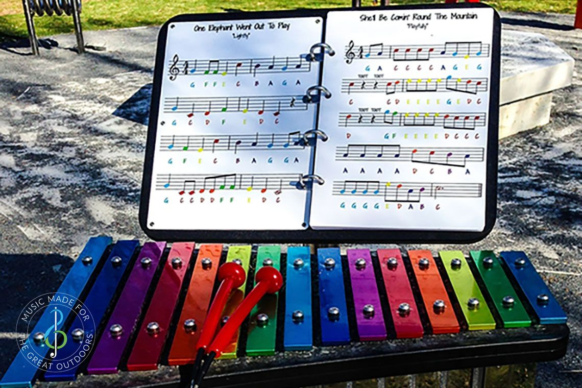 Rainbow Coloured Outdoor Xylophone in Park with music stand