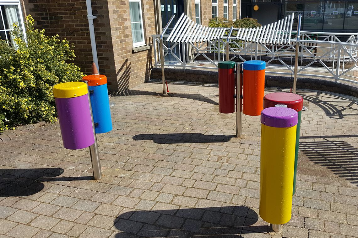 colourful outdoor drums on playground in treloars school