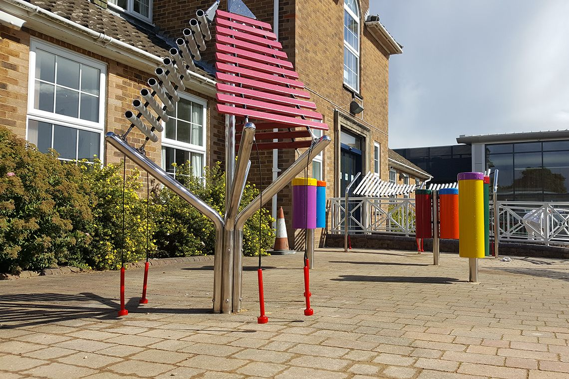 outdoor xylophone installed in special needs school playground
