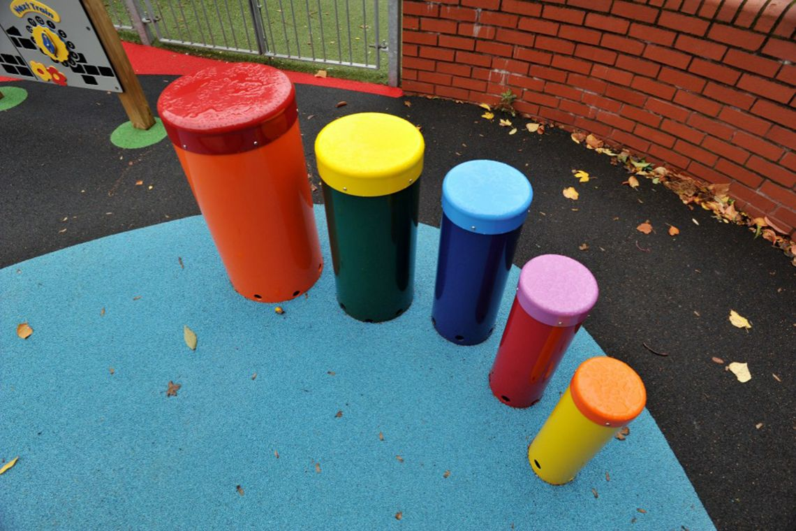 five colourful playground drums